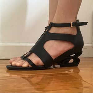 Perfect black sandals with architectural heel
